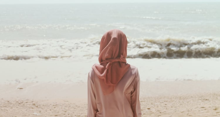 woman wearing scarf at the beach