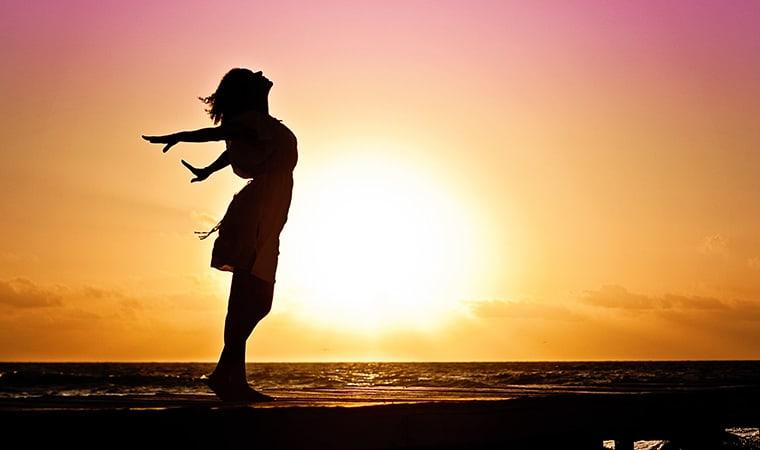 Woman happiness sunrise
