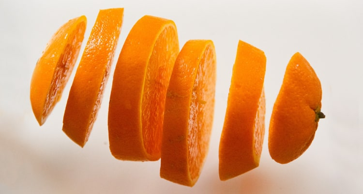 sliced orange floating