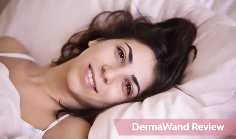 A woman lying on a pink bed