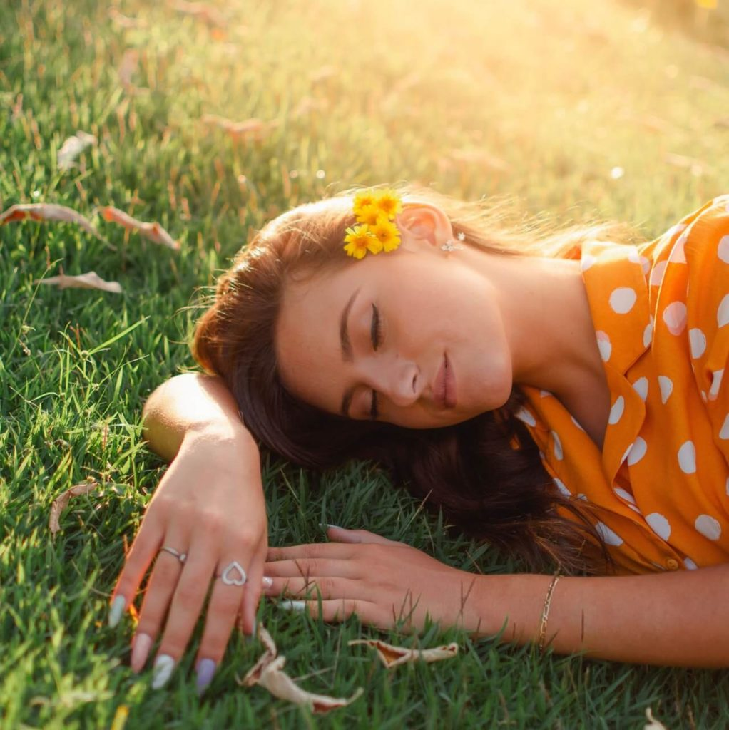 woman lying on the grass smiling